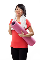 Healthy woman with yoga mat