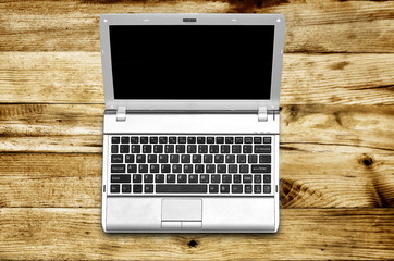 Laptop on wood background