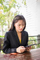 Beautiful Asian business woman using tablet for communication