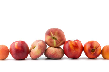 Peach, nectarine, apricot on background cherries isolated on whi