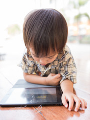Asian boy play tablet fun