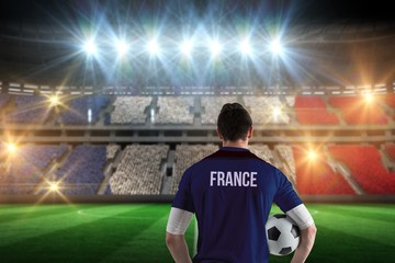 Composite image of france football player holding ball