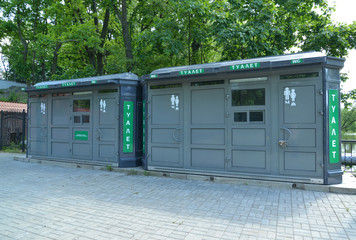 Two new public toilets stand on the street