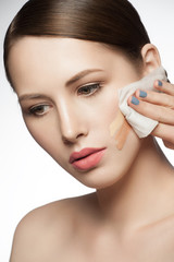Woman clean her face