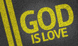 Постер, плакат: God Is Love written on the road