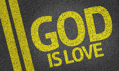 God Is Love written on the road