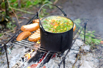 The cooking of soup on the fire