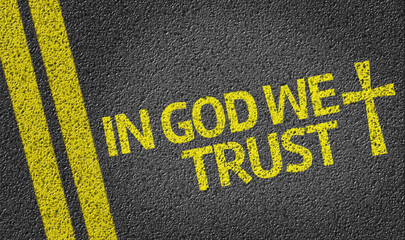 In God We Trust written on the road