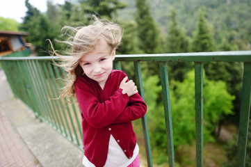 Cute little girl on a very windy day
