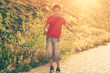 Boy in red t-shirt backlit