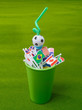 Drinking straw in green cup with many nation flag