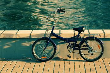 Side view of a bike near lake