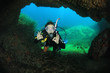 Young woman scuba diving in underwater cave - 66103511