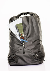 Brown backpack with stationary isolated on background
