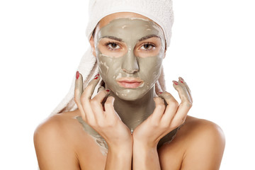 young beautiful woman posing with a mask on her face