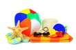 Group of colorful beach items over white