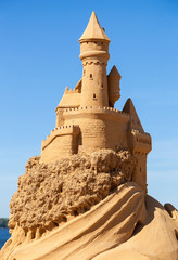 A beautiful sculpture of sand castle against blue sky