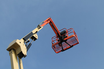 The Cage and Arm of a Mechanical Cherry Picker Lift.