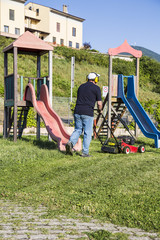 mowing the grass at the park