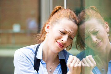 Stressed corporate employee standing outside company office