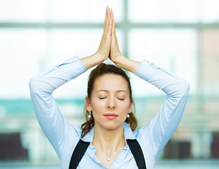Portrait meditating business woman, corporate office background