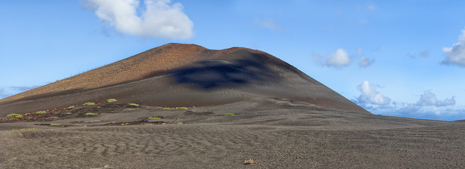 Panoramic view into lava fields and volcanoes, Lanzarote