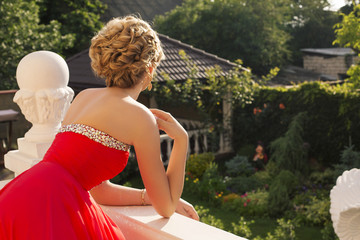glamour blond woman in elegant dress posing at luxury villa