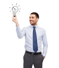 handsome businessman holding light bulb