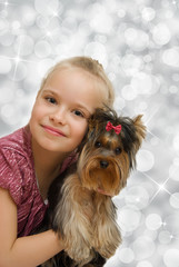 Young girl with cute Yorkshire terrier - best friends