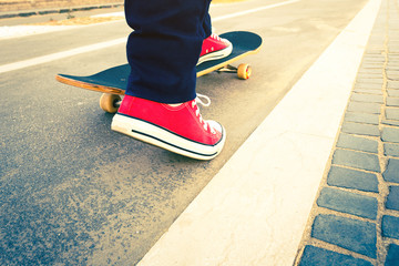 skateboarder trick in beach road