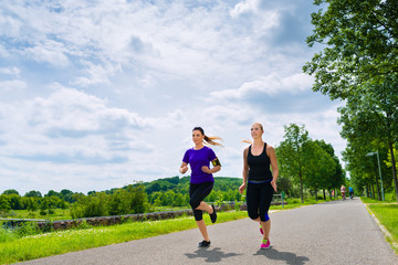 Sports outdoor - young women running in park