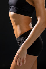 close up of athletic female abs in sportswear