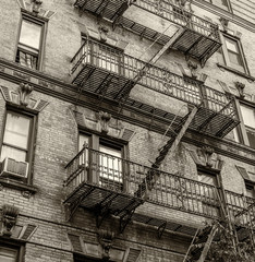 Building with green ladders for fire escape, Mott Street New Yor