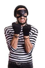 Angry burglar with handcuffs