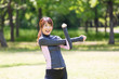 young asian woman exercising in the park