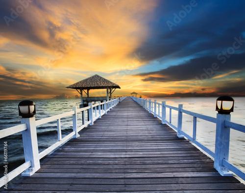 wood piers and sea scene with dusky sky