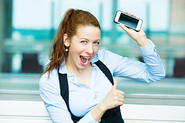 Portrait excited businesswoman with smart phone