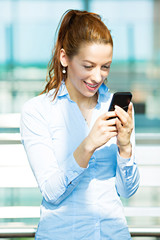 Portrait business woman texting on phone