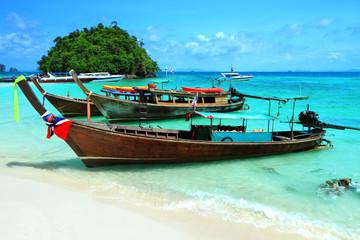 Long tail boats by the shore at Tup island Kra bi Andaman sea of