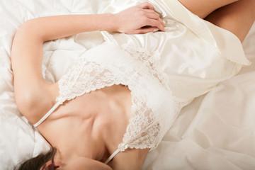 Perfect woman's body in white sexy nightwear