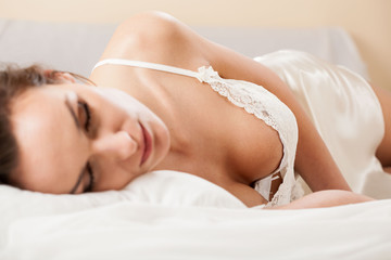 Woman sleeping in sexy nightwear