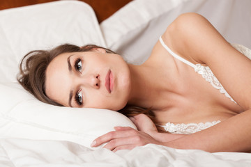 Woman lying awake in bed