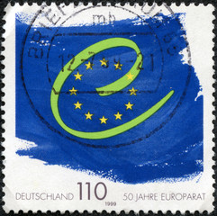 stamp printed in Germany shows flag and symbol of Europe