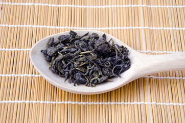 Kerala state green indian tea in wooden spoon