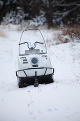 snowmobile in winter forest