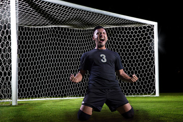 Hispanic Soccer Player celebrating a goal