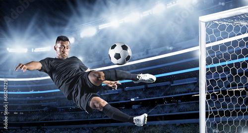 Plexiglas Sportwinkel Hispanic Soccer Player kicking the ball