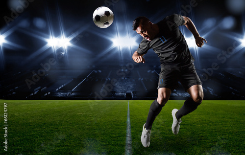canvas print picture Hispanic Soccer Player heading the ball