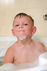 Young boy bathing in the tub