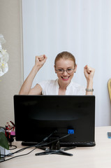 Successful business woman working online on a laptop computer.